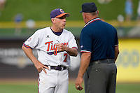 Clemson Tigers head coach Jack Leggett #7 discusses a call with umpire Tony Maners at Durham Bulls Athletic Park May 23, 2009 in Durham, North Carolina. The Tigers defeated the Tar Heals 4-3 in 11 innings.  (Photo by Brian Westerholt / Four Seam Images)