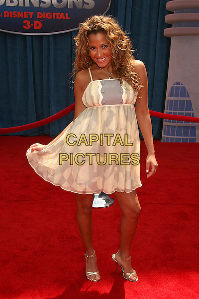 "ADRIENNE BAILON .""Meet The Robinsons"" Los Angeles Premiere at the El Capitan Theatre, Hollywood, California, USA..March 25th, 2007.full length beige yellow grey gray dress pattern sheer .CAP/ADM/BP.©Byron Purvis/AdMedia/Capital Pictures"