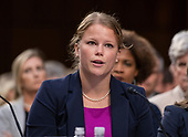 Alicia Baker of Indianapolis, Indiana testifies against the nomination of Judge Brett Kavanaugh before the US Senate Judiciary Committee on his nomination as Associate Justice of the US Supreme Court to replace the retiring Justice Anthony Kennedy on Capitol Hill in Washington, DC on Friday, September 7, 2018.<br /> Credit: Ron Sachs / CNP