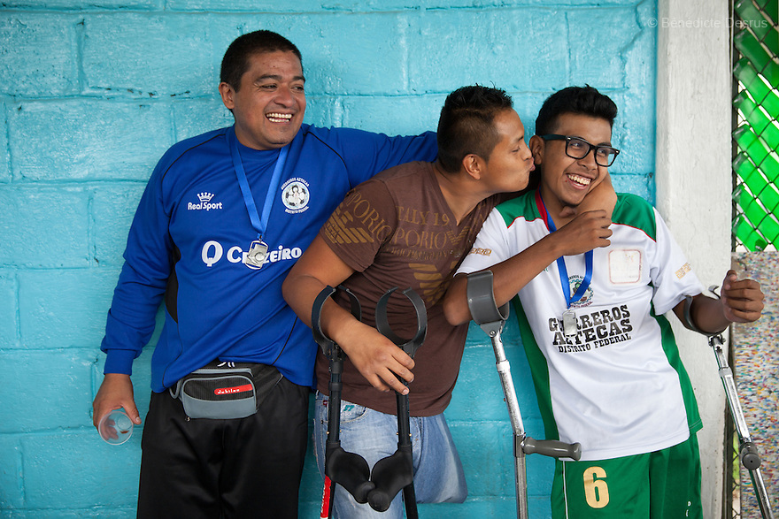 """Baruch with his teammates at Guerreros Aztecas's first anniversary celebrations. in Mexico City, Mexico on July 5, 2014. Baruch Alejandro Anleu Ramirez, 18, is the captain of Guerreros Aztecas. Two years ago, Baruch had his left leg amputated due to bone cancer. He used to practice as much as his chemotherapy would allow. Expelled from school for missing too many classes during his treatment, he says, """"Guerreros Aztecas has filled a big hole in my life"""". Baruch was Guerreros Aztecas's brightest hope to represent Mexico at the Amputee Soccer World Cup. But since the cancer's spread to his lungs, he can no longer play or train with the team. Guerreros Aztecas (""""Aztec Warriors"""") is Mexico City's first amputee football team. Founded in July 2013 by five volunteers, they now have 23 players, seven of them have made the national team's shortlist to represent Mexico at this year's Amputee Soccer World Cup in Sinaloathis December.The team trains twice a week for weekend games with other teams. No prostheses are used, so field players missing a lower extremity can only play using crutches. Those missing an upper extremity play as goalkeepers. The teams play six per side with unlimited substitutions. Each half lasts 25 minutes. The causes of the amputations range from accidents to medical interventions – none of which have stopped the Guerreros Aztecas from continuing to play. The players' age, backgrounds and professions cover the full sweep of Mexican society, and they are united by the will to keep their heads held high in a country where discrimination against the disabled remains widespread.(Photo byBénédicte Desrus)"""