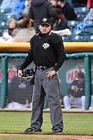 Home plate umpire Roberto Ortiz as the Sacramento River Cats faced the Salt Lake Bees in Pacific Coast League action at Smith's Ballpark on April 5, 2014 in Salt Lake City, Utah.  (Stephen Smith/Four Seam Images)