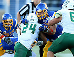 BROOKINGS, SD - SEPTEMBER 17:  Kellen Soulek #94 from South Dakota State University wraps up Kori Garcia #24 from Cal Poly in the first half of their game Saturday night at the Dana J. Dykhouse Stadium in Brookings. (Photo by Dave Eggen/Inertia)