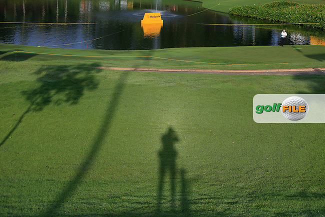 A lonely silhouette at the 1st tee during Round 3 of the Maybank Malaysian Open at the Kuala Lumpur Golf &amp; Country Club on Saturday 7th February 2015.<br /> Picture:  Thos Caffrey / www.golffile.ie