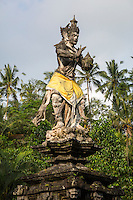 Bali, Indonesia.  Statue of Hindu God Indra Bringing Holy Water at Tirta Empul, a Spring Sacred to Balinese Hindus.  The Balinese believe that Indra created the spring at Tirta Empul.