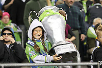 Fans of the Seattle Sounders FC hold up a home made US Cup. The Seattle Sounders FC defeated the Columbus Crew 2-1 during the US Open Cup Final at Qwest Field in Seattle,WA, on October 5, 2010.