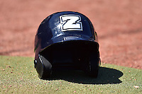 A New Orleans Zephyr batting helmet sits near the dugout prior to the New Orleans Zephyrs game against the Iowa Cubs at Principal Park on April 23, 2015 in Des Moines, Iowa.  The Zephyrs won 9-2.  (Dennis Hubbard/Four Seam Images)