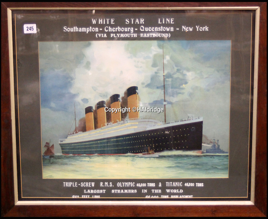 BNPS.co.uk (01202 558833)<br /> Pic: HAldridge/BNPS<br /> <br /> This £4,000 artwork shows the RMS Titanic or Olympic leaving harbour.<br /> <br /> An incredibly rare travel poster advertising trips on the Titanic has been discovered on the back of painting that has been hidden behind a false wall for 100 years.<br /> <br /> A couple renovating their Victorian home in Wales stumbled upon the lithographic poster after knocking through a stud wall in their living room.<br /> <br /> It is being sold for £3,000 along with two other vintage promotional posters for the ill-fated liner at auction in Wiltshire.