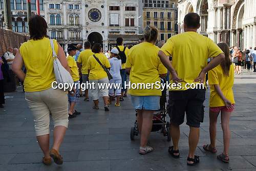 Venice Italy 2009. Tour group in yellow t shirts Saint Marks Square. Piazza  San Marco.