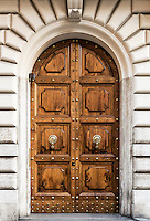 Ornate arched double door, Rome, Italy