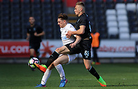 SWANSEA, WALES - MARCH 25: Daniel James of Swansea City is challenged by Oleg Reabciu of Porto during the Premier League International Cup Semi Final match between Swansea City and Porto at The Liberty Stadium on March 25, 2017 in Swansea, Wales. (Photo by Athena Pictures)