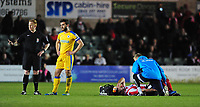 Lincoln City's Matt Rhead receives treatment for an injury from Lincoln City's head of sports science and medicine Mike Hine<br /> <br /> Photographer Chris Vaughan/CameraSport<br /> <br /> Vanarama National League - Lincoln City v Chester - Tuesday 11th April 2017 - Sincil Bank - Lincoln<br /> <br /> World Copyright &copy; 2017 CameraSport. All rights reserved. 43 Linden Ave. Countesthorpe. Leicester. England. LE8 5PG - Tel: +44 (0) 116 277 4147 - admin@camerasport.com - www.camerasport.com