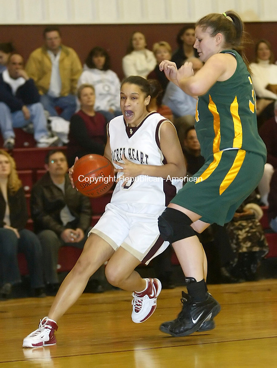 WATERBURY, CT, 02/15/07- 021507BZ11- Sacred Heart's Kayla Kennedy (3) drives past Holy Cross's Chelsea Cracco (34)<br /> during their game at Sacred Heart Thursday night.<br /> Jamison C. Bazinet Republican-American