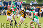 Abbeydorney's Richard Nolan, gives support to team mate Tom B McElligott as he surges forward with the ball despite the close attentions of Crotta's PJ Keane and Colm Browne in last Saturday's match in Ballyduff.