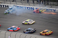 Nov. 8, 2009; Fort Worth, TX, USA; NASCAR Sprint Cup Series drivers Carl Edwards (99) and Juan Pablo Montoya (42) crash during the Dickies 500 at the Texas Motor Speedway. Mandatory Credit: Mark J. Rebilas-