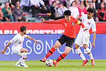 Son Heungmin of South Korea (C) fights for the ball with Akram Hassan Afif of Qatar (R) and Abdulkareem Salem Al-Ali of Qatar (L) during the AFC Asian Cup UAE 2019 Quarter Finals match between Qatar (QAT) and South Korea (KOR) at Zayed Sports City Stadium  on 25 January 2019 in Abu Dhabi, United Arab Emirates. Photo by Marcio Rodrigo Machado / Power Sport Images