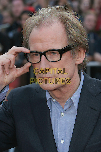 "BILL NIGHY.""Pirates Of The Caribbean: At World's End"" World Premiere held at Disneyland, Anaheim, California, USA,.19 May 2007..portrait headshot glasses touching.CAP/ADM/CH.©Charles Harris/AdMedia/Capital Pictures."