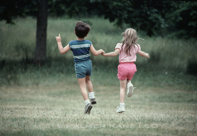 Little boy and girl skipping