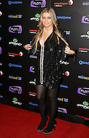 CARMEN ELECTRA .At SWAGG VIP Kid Rock Concert at the Joint inside the Hard Rock Hotel and Casino, Las Vegas, Nevada, USA,.7th January 2010..full length black leather jacket dress tights necklace platform shoes pearls beads hands taking off .CAP/ADM/MJT.© MJT/AdMedia/Capital Pictures.