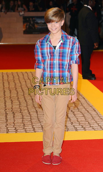 Ronan Parke.'The Three Musketeers in 3D' world film premiere, Vue Cinema, Westfield Shopping Centre, London, England..October 4th 2011.full length blue red white check shirt shoes beige trousers .CAP/BEL.©Tom Belcher/Capital Pictures.