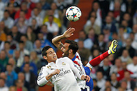 Real Madrid's Colombian midfielder James Rodriguez and Atletico Madrid´s Spanish defense Jesus Gamez