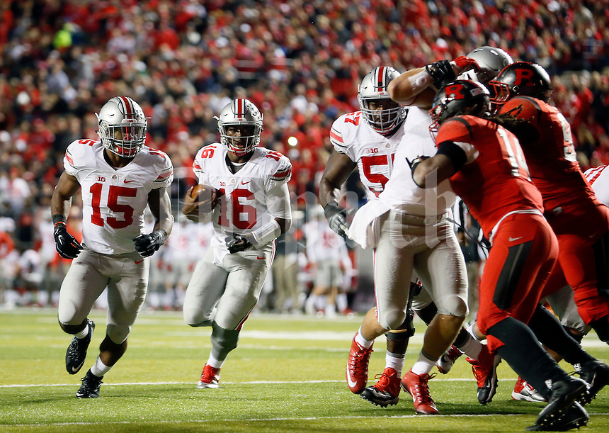 Ohio State Buckeyes quarterback J.T. Barrett (16) follows a block by Ohio State Buckeyes running back Ezekiel Elliott (15) against Rutgers Scarlet Knights in the first half at High Point Solutions Stadium on October 24, 2015.  (Dispatch photo by Kyle Robertson)