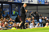 Portsmouth Manager Kenny Jackett checks his watch with 2 mins to go during Portsmouth vs Birmingham City, Caraboa Cup Football at Fratton Park on 6th August 2019