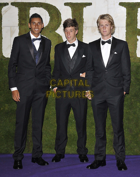 Filip Peliwo ( centre ), 2012 Boy's Singles Champion, & guests.2012 Wimbledon Champions Dinner arrivals, InterContinental Hotel, Park Lane, London, England..8th July 2012.full length black tuxedo .CAP/CAN.©Can Nguyen/Capital Pictures.
