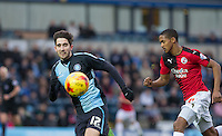 Max Kretzschmar of Wycombe Wanderers beats Lewis Young of Crawley Town to the ball during the Sky Bet League 2 match between Wycombe Wanderers and Crawley Town at Adams Park, High Wycombe, England on 28 December 2015. Photo by Andy Rowland / PRiME Media Images