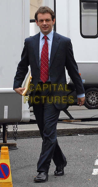 "MICHAEL SHEEN.On the set of ""The Special Relationship"", London, England..July 20th, 2009.acting Tony Blair full length black suit red tie blue shirt walking .CAP/IA.©Ian Allis/Capital Pictures."