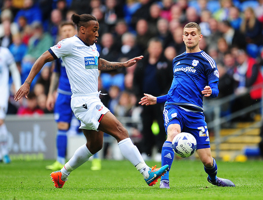 Bolton Wanderers' Neil Danns vies for possession with Cardiff City's Stuart O'Keefe<br /> <br /> Photographer Kevin Barnes/CameraSport<br /> <br /> Football - The Football League Sky Bet Championship - Cardiff City v Bolton Wanderers - Saturday 23rd April 2016 - Cardiff City Stadium - Cardiff <br /> <br /> &copy; CameraSport - 43 Linden Ave. Countesthorpe. Leicester. England. LE8 5PG - Tel: +44 (0) 116 277 4147 - admin@camerasport.com - www.camerasport.com