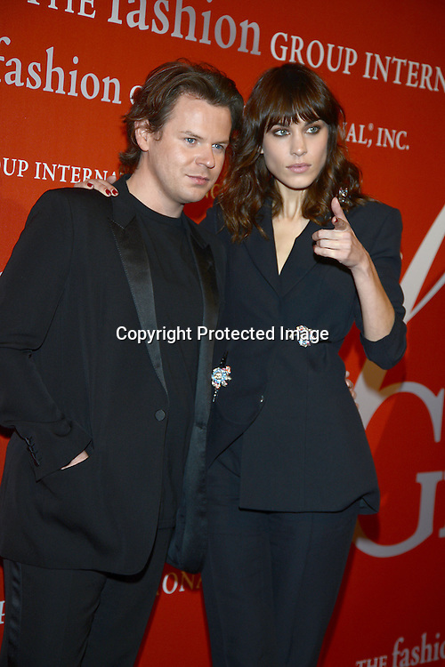 Christopher Kane and Alexa Chung in Christopher Kane suit attends the Fashion Group International's Night of Stars Gala on October 22, 2013 at Cipriani Wall Street in New York City.