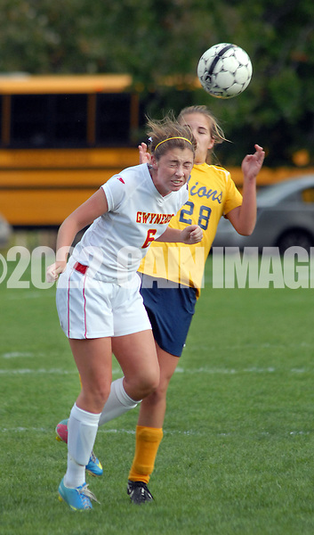 LOWER GWYNEDD, PA -  OCTOBER 23: Gwynedd Mercy Academy's Meredith D'Angelo (6) uses her head to dribble the soccer ball as Lower Moreland's Kritin Wolfgang (28) (EDS NOTE: NAME SPELLED FROM ROSTER) chases during a District One Class AA playoff game October 23, 2013 in Lower Gwynedd, Pennsylvania. Gwynedd Mercy Academy defeated Lower Moreland 5-1. (Photo by William Thomas Cain/Cain Images)