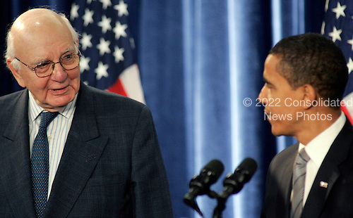Chicago, IL - November 26, 2008 -- United States President-elect  Barack Obama, right, looks at Paul Volcker during a news conference Wednesday, November 26, 2008, in Chicago, Illinois. .Credit: Frank Polich - Pool via CNP
