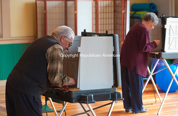NEW HARTFORD, CT-050614JS01--Al Brunoli and his wife Annette Brunoli of New Hartford, cast their vote on the Region 7 budget proposal for 2014-15 Tuesday at the New Hartford Town Hall. <br /> Jim Shannon Republican-American