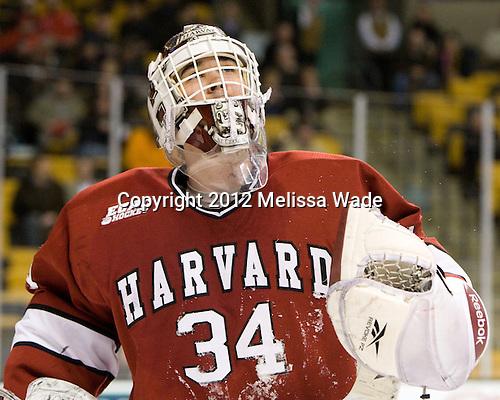 Steve Michalek (Harvard - 34) - The Harvard University Crimson defeated the Northeastern University Huskies 3-2 in the 2012 Beanpot consolation game on Monday, February 13, 2012, at TD Garden in Boston, Massachusetts.