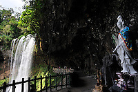 Path leading to cascade of Dam Bri waterfall, with statue of Pho Hien Bo Tat, the Bodhisattva associated with Buddhist practise and meditation. A Bodhisattva is an enlightened being who forgoes personal Nirvana to help others..Dam Bri waterfall, Da Lat, Vietnam