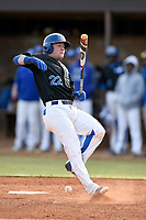 Third baseman Joey Tepper (22) of the Spartanburg Methodist College Pioneers gets out of the way of a pitch in Game 1 of a junior college season-opening doubleheader against the Patrick Henry Patriots on February 3, 2018, at Mooneyham Field in Spartanburg, South Carolina. (Tom Priddy/Four Seam Images)