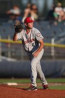 Derek Thompson #40 of the Spokane Indians pitches against the Salem-Keizer Volcanoes at Volcanoes Stadium on July 26, 2014 in Keizer, Oregon. Spokane defeated Salem Keizer, 4-1. (Larry Goren/Four Seam Images)