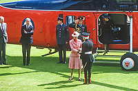 Princess Anne on a May 1985 visit to N Ireland is welcomed by Lord Glentoran, 2nd Baronet, Lord Lieutentant of Belfast, on her arrival by helicopter at the official opening of an extension to Belfast Royal Academy's Preparatory Department at its Ben Madigan campus. 19850501p.<br />