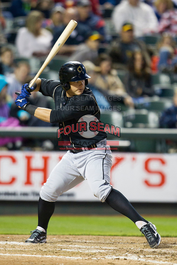 Omaha Storm Chasers catcher Adam Moore #6 at bat against the Round Rock Express in the Pacific Coast League baseball game on April 4, 2013 at the Dell Diamond in Round Rock, Texas. Round Rock defeated Omaha in their season opener 3-1. (Andrew Woolley/Four Seam Images).