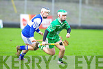 St Brendan's Gearoid Silles tries to stop Ballyduff's David Goulding in the U21 hurling championship at Austin Stack Park.