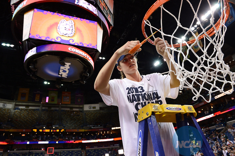 09 APR 2013: Kelly Faris of UCONN cutes down the net during the Division I Women's Basketball Championship held at the New Orleans Arena in New Orleans, LA. UCONN Defeated Louisville 93-60 to claim the national title. Stephen Nowland/NCAA Photos