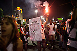 """A man with a flare carries a sign that looks like a shield of """"Choque,"""" a military police unit, that reads """"Brazil has awaken,"""" in downtown Rio de Janeiro, on Thursday, June 20, 2013. About 300,000 Cariocas (residents of Rio de Janeiro) protest downtown against the government, which began with a 20-cent hike in public transport fares, and moved to widespread frustration about a heavy tax burden, corrupt politicians and weak public education, health and transport systems, as the nation hosts the Confederations Cup soccer tournament and prepares for next month's papal visit.The demonstrations came despite the government's U-turn over public transport fare hikes which sparked the protests over a week ago."""