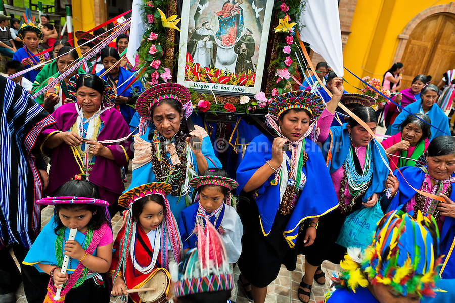 "Native women from the Kamentsá tribe, wearing colorful costumes, take part in the procession during the Carnival of Forgiveness, a traditional indigenous celebration in Sibundoy, Colombia, 12 February 2013. Clestrinye (""Carnaval del Perdón"") is a ritual ceremony kept for centuries in the Valley of Sibundoy in Putumayo (the Amazonian department of Colombia), a home to two closely allied indigenous groups, the Inga and Kamentsá. Although the festival has indigenous origins, the Catholic religion elements have been introduced and merged with the shamanistic tradition. Celebrating annually the collaboration, peace and unity between tribes, they believe that anyone who offended anyone may ask for forgiveness this day and all of them should grant pardons."
