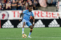 FOXBOROUGH, MA - SEPTEMBER 29: Sebastien Ibeagha #33 of New York City FC dribbles at midfield during a game between New York City FC and New England Revolution at Gillette Stadium on September 29, 2019 in Foxborough, Massachusetts.