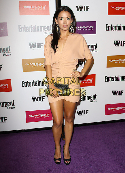 STEPHANIE JACOBSEN.2009 Entertainment Weekly & Women In Film pre-Emmy party held At The Sunset Marquis Hotel, West Hollywood, California, USA..September 17th, 2009.emmys full length beige dress black clutch bag hand on hip.CAP/ADM/KB.©Kevan Brooks/AdMedia/Capital Pictures.