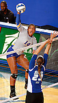 BROOKINGS, SD - SEPTEMBER 1:  Mikala Hora #14 from South Dakota State looks to get a kill past Katie Allen #23 from Drake in the Jacks home opener Tuesday night at Frost Arena.  (Photo by Dave Eggen/Inertia)