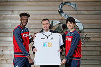 Pictured: Paul Fox, CEO of Letou (C) with the Chinese version of the Swansea City FC shirt held by players Tammy Abraham (L) and Ki Sung-Yueng (R) at Fairwood training ground, Wales, UK