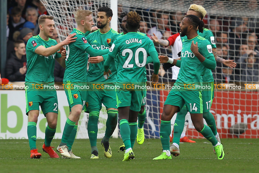 Watford celebrate their goal in the first half scored by Will Hughes (2nd left) during Woking vs Watford, Emirates FA Cup Football at The Laithwaite Community Stadium on 6th January 2019