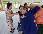Participants engage in a group exercise during an ecumenical workshop on women's empowerment in Kalay, Myanmar. The workshop was sponsored by the Women's Department of the Myanmar Council of Churches and led by Emma Cantor (left), a regional missionary for United Methodist Women.